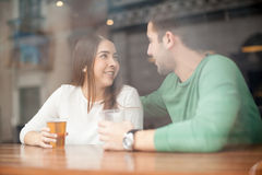 Free Cute Girl Flirting With A Guy At The Bar Stock Photography - 68073482