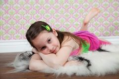 Cute girl on the floor Royalty Free Stock Photography