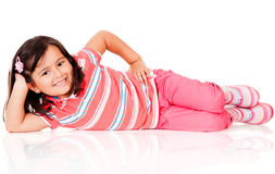 Cute girl on the floor Stock Photos