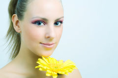 Cute girl with flower. Royalty Free Stock Image