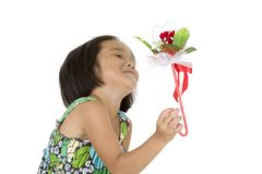 Cute girl with flower gift Stock Photo