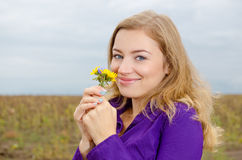 Cute girl with flower. Cute smiling girl with flower royalty free stock photo