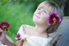 The cute girl with flowers Royalty Free Stock Images