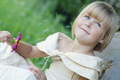The cute girl with flowers Stock Images