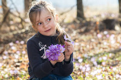 Cute girl with flowers Royalty Free Stock Image