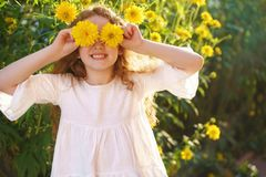 Cute girl with flowers eyes showing white teeth, in a summer out Stock Images