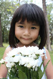 Cute girl with flowers Royalty Free Stock Photo