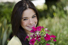 Cute girl with flowers Stock Photos