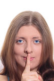 Cute girl with a forefinger pressed to lips Stock Photography