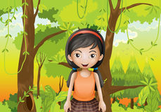 A cute girl at the forest with an orange sando Royalty Free Stock Photo