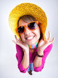Cute girl with funny hat smiling in the studio Stock Photography