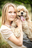 Cute girl with funny looking dog Stock Images