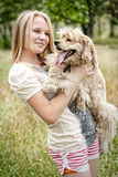 Cute girl with funny looking dog Royalty Free Stock Images