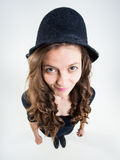 Cute girl with funny peasant hat smiling in the studio Royalty Free Stock Photo