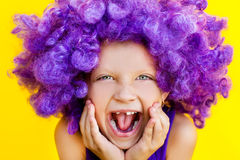 Cute girl in funny wig Stock Image