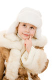 Cute girl in a fur coat and hat smiling Royalty Free Stock Photography