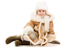 Cute girl in a fur coat and hat smiling Stock Image