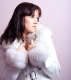 Cute girl with a furry coat Royalty Free Stock Photos