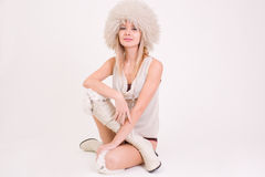 Cute girl in furry hat. Studio shot stock images
