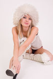 Cute girl in furry hat. Studio shot royalty free stock photography