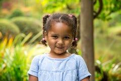 Cute girl in garden Royalty Free Stock Photos