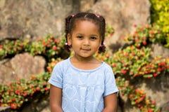 Cute girl in garden Stock Photography