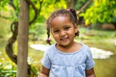 Cute girl in garden Stock Image