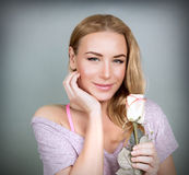 Cute girl with gentle rose Royalty Free Stock Image