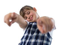 Cute girl gesturing againt white bcakground. Portrait of cute girl gesturing againt white bcakground Royalty Free Stock Images