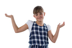Cute girl gesturing againt white bcakground. Portrait of cute girl gesturing againt white bcakground Stock Images