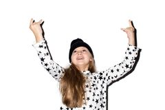 Cute girl gesturing rock at camera. Adorable girl showing devil`s horns gesture isolated. Child looks up Stock Photography