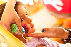 Cute Girl Gets A Face Painting At A Party Stock Photography