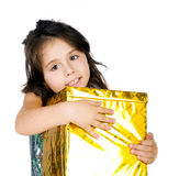 Cute girl with a gift Royalty Free Stock Images