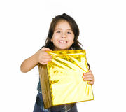 Cute girl with a gift Royalty Free Stock Photos