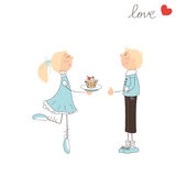 Cute girl give cake to the boy Stock Image