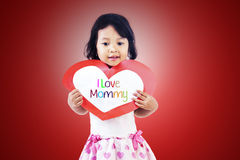 Cute girl give love card to mom Royalty Free Stock Photos