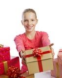 Cute girl giving a present Royalty Free Stock Photos
