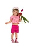 Cute girl giving tulips Stock Photos