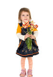 Cute girl giving tulips Royalty Free Stock Photography