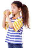 Cute girl with glass of juice Stock Photography