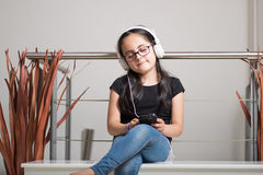 Cute girl with glasses listening to music Royalty Free Stock Photo