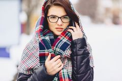 cute girl in glasses and a scarf royalty free stock photos