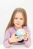 A cute girl with globe is dreaming about travels. And travelling Royalty Free Stock Photos