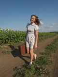 Cute girl goes on a dirt road Royalty Free Stock Image