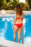 Cute girl going inside the pool Royalty Free Stock Images
