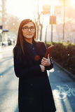 Cute girl is going to a lecture early in the morning Stock Images
