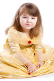 Cute girl in golden dress Royalty Free Stock Photos