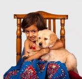 Cute girl with Golden Retriever puppy Royalty Free Stock Photos