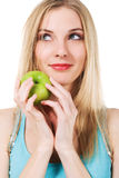 Cute girl with green apple Stock Images