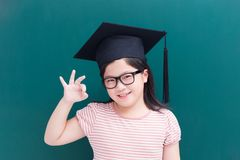 Cute girl with green chalkboard Stock Images